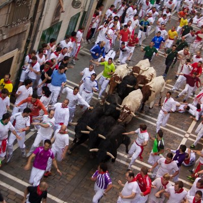 Runners take on the bulls on Estafeta Street