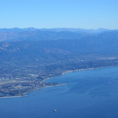 South Coast of Santa Barbara County, view looking northeast, showing, from left to right, Isla Vista, Goleta, Hope Ranch, Santa Barbara. All the mountains except for the most distant in the right rear are in Santa Barbara County.