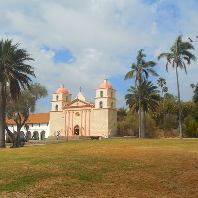 View of the Santa Barbara Mission and aqueduct wall (right) from Mission Historical Park's grassy area in Santa Barbara, California, 2015