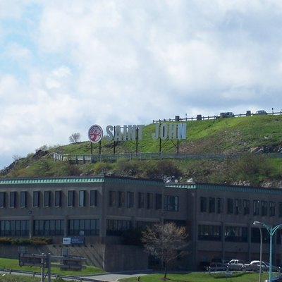 Photo of the Hollywood-style 'Saint John' sign on the Fort Howe hillside in Saint John, New Brunswick, Canada. Sign was erected by the city in late 1999 as party of the millenium year 2000 celebrations. It is still maintained by the city and lit up at night.