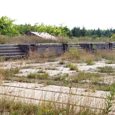 Abandoned concrete gun platforms, formerly part of the Proof Battery of the Sandy Hook Proving Ground, in use from 1901-1919. Soldiers used a 20-foot gantry crane on rails to lift guns and carriages onto the platforms to be tested, or