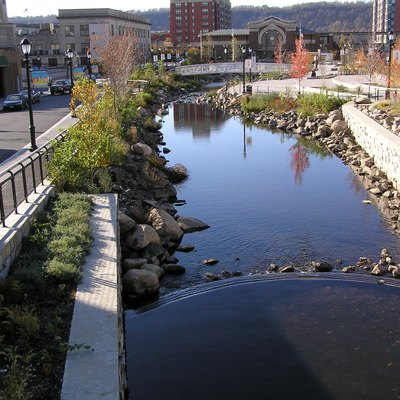 The city of Yonkers recently excavated Getty Square and reintroduced the confluence of the Saw Mill River as it enters the Hudson River. The parking lot has been removed and the Square is much more pleasant to look at.