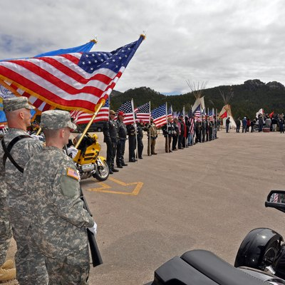 CRAZY HORSE, S.D. - Soldiers of the South Dakota Army National Guard's Color Guard prepare to post the American flag on May 15, 2011, during a welcome ceremony for the UH-72A Lakota Light Utility Helicopter held at the Crazy Horse Memorial near Custer, S.D. The ceremony was attended by members of both the National Guard and the Lakota Tribes who celebrated their diversity and unity during the all day event at the memorial. (South Dakota Army National Guard photo by Staff Sgt. Lance Alan Schroeder)