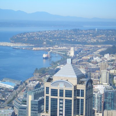 A view of Seattle looking north from the observation deck of Columbia Center. North downtown, grain terminal, and Magnolia can be seen.