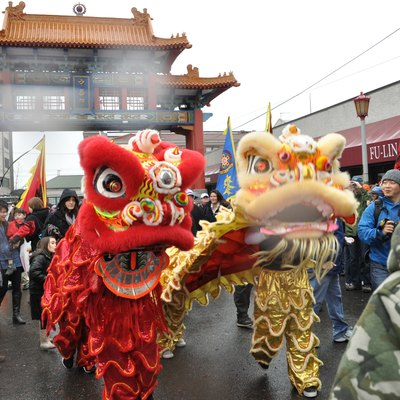 Lion dancers at Historic Chinatown Gate, Chinese New Year, Hing Hay Park, Seattle, Washington.