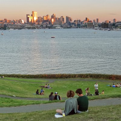 The Seattle skyline at sunset, seen across Lake Union from