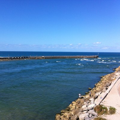 Sebastian Inlet, Florida. The North Jetty Is On The Left And The South Jetty Is On The Right. Photograph Taken From The Sebastian Inlet Bridge On Florida State Highway A1A.