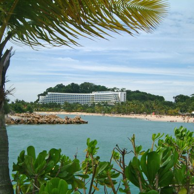 Siloso beach in Sentosa, showing a sheltered cove with a sandy beach used for recreation. The building in the background is the Shangri-La Rasa Sentosa Resort. Image Captured by Calvin Teo, in December 2005