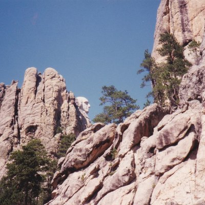 I took photo in August 1990 at Mount Rushmore of profile shot of Washington. Do not recall name of camera.