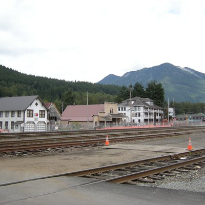 The heart of Skykomish, Washington. The building at left is the Skykomish Historical Society Museum. The large white building at center-right is the Skykomish Hotel. In between is Maloney's General Store, listed on the National Register of Historic Places. At far right is the Cascadia Hotel and Café. BNSF railway tracks in foreground.