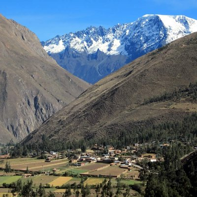 The eternal snows of the Andes rise above the Sacred Valley near Ollantaytambo, Peru.