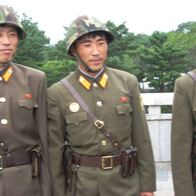 A trio of friendly North Korean soldiers at Panmunjon.