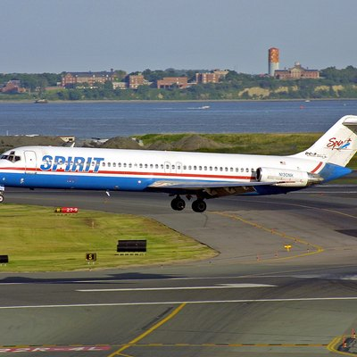 Spirit Airlines - old colors - lands at Logan Airport Boston, Massachusetts.