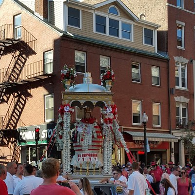 A life size statue of St. Agrippina di Mineo in a ornate canopy accompanied by the North End Marching Band in Boston.