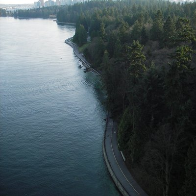 A aerial view of Stanley Park seawall facing east, towards downtown.