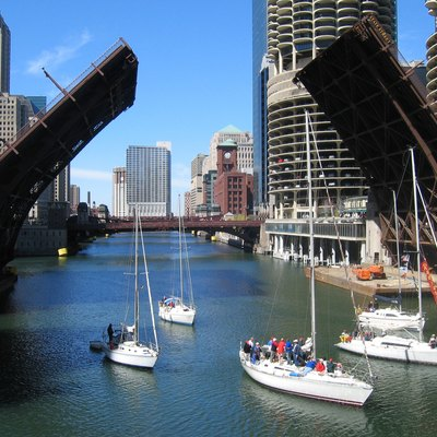 A small flotilla of boats passes through the open State Street Bridge on the Chicago River, Chicago, Illinois.
