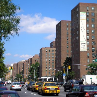 Stuyvesant Town seen from 1st Avenue and 14th Street. A sign advertising luxury rentals can be seen clearly.