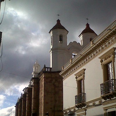 This is a picture, taken from Azurduy street in front of Convento de San Felipe de Neri in Sucre, Bolivia.