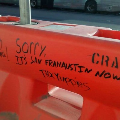 Construction barrier on South Congress in Austin Texas - Summer 2015. Shows sentiment towards development of the city.