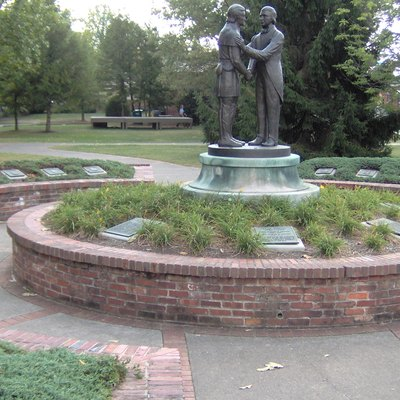The Governor's Circle at Constitution Square State Historic Site. A memorial honoring Kentucky governors with a bronze statue depicting the Kentucky state seal surrounded by plaques dedicated to each governor.