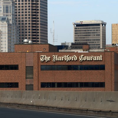 The Hartford Courant building in downtown Hartford, seen from I-84 East.