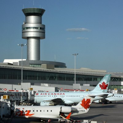 Terminal 1 of Toronto Airport with Air Canada aircraft and the tower