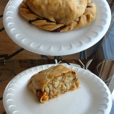 A traditional Yooper pasty (whole and a cross section; a beef pasty). Picked up from Muldoons Pasties, Munising, Michigan, USA.