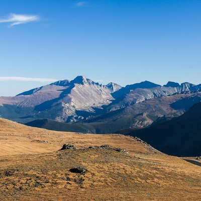 Trail Ridge Road, with Longs Peak (left of center), Pagoda Peak (center, in sun), Chief's Head (right of center, in shadow), and Mount Terra Tomah (at far right edge, in shadow), from 12,000 feet above sea level in Rocky Mountain National Park