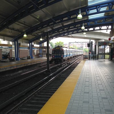 A northbound Blue Line train approaches the platform at the MBTA's Airport Station.