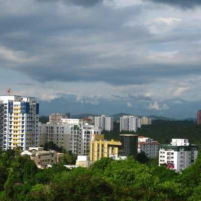 The green Skyline of Pattom, The northern shopping suburb of Trivandrum City, Kerala, India. The City is Known as the Evergreen City. The western ghats mountain range is seen in the background.