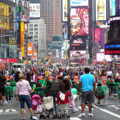 Looking north up Broadway from 43d Street, full zoom, with people using the green beach chairs distributed by the local BID. Replaced, in the w:Times Square article, File:TSq Bwy pedestrianized jeh.jpg.