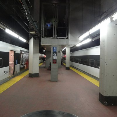 Two NJ Transit trains on tracks 3 and 4 of New York Penn Station.