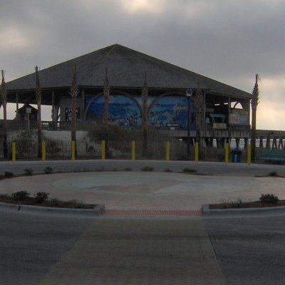The Tybee Island Pavilion and Pier at Tybee Island, Georgia, in the southeastern United States. The pier and pavilion were constructed in 1996 to replace the Tybrisa Pavilion, which had burned in 1967.