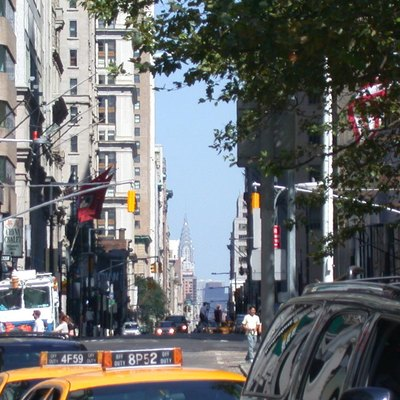 A view up Broadway from Bowling Green (New York City), with Chrysler Building in the background.