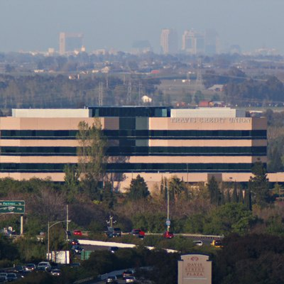 Travis Credit Union Headquarters in Vacaville, CA, USA. Sacramento skyline can been seen in the distance.