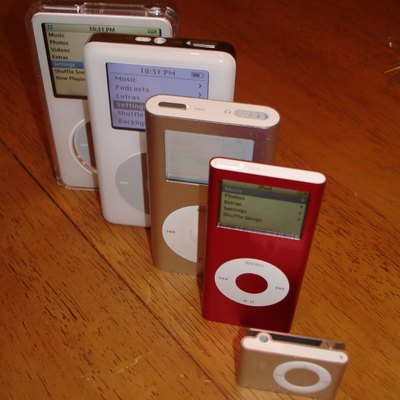 A stack of the iPods I now own... included are the 1Gb iPod shuffle (2nd Gen), iPod nano Product(RED) 4Gb (2nd Gen), iPod mini 4Gb, iPod 20Gb (4th Gen), and iPod video 80Gb (5.5 Gen).