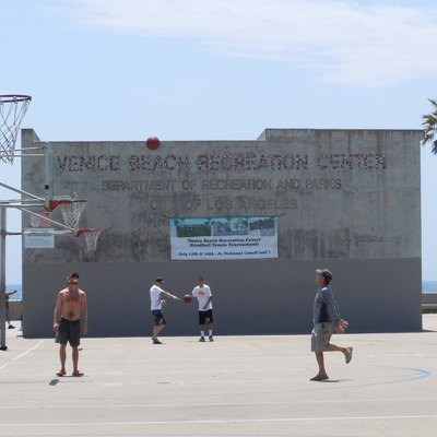 A Man Practicing Basketball At The Venice Beach Recreation Center In California