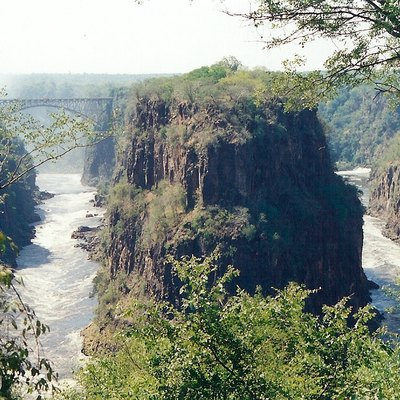 Victoria Falls Gorge And Bridge, Seen From The Turn Of The Hairpin Bend Below The Falls, After Good Rains. The Penisular Cliffs Are In Zambia, The Outer Cliffs In Zimbabwe. In The Top Left-Hand Corner Can Be Seen The White Mist Of The Falls Themselves, Where The Zambezi Plunges Into The Gorge. Taken In April 1995 On Fujifilm.