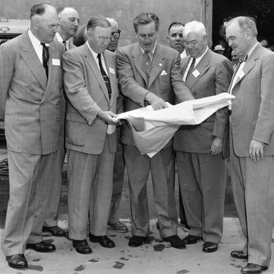 Walt Disney Shows Disneyland Plans To Orange County Officials In December 1954. The Men In The Front Row (Left To Right) Are Anaheim Mayor Charles Pearson, Orange County Supervisor Willis Warner, Walt Disney, Supervisor Willard Smith, And Orange County Planning Commission Chairman Dr. W. L. Bigham. The Photo Was Taken At Disney Studios In Burbank.