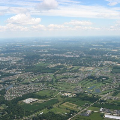 Aerial view of southern Washington Township, Montgomery County, Ohio, United States, with the city of Centerville in the distance. The major intersection on the right side of the picture, south of the Yankee Trace Golf Course, is that of Yankee Street and Austin/Social Row Road. Picture taken from a Diamond Eclipse light airplane at an altitude of 3,450 feet MSL and a bearing of approximately 250º.