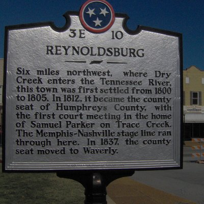 Tennessee Historical Commission marker recalling the now-defunct town of Reynoldsburg, Tennessee, in the southeastern United States. Reynoldsburg was a major stage coach hub on the road between Nashville and Memphis in the early 1800s. This marker is located in nearby Waverly, which succeeded Reynoldsburg as the county seat in 1835.