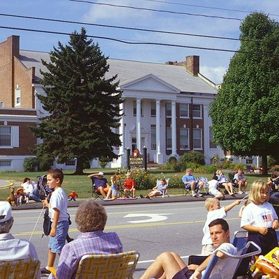 Wells Junior High School in Wells, Maine. This building was constructed in 1937 as the third Wells High School; it became Wells Junior High School in 1977. It is located at 1470 Post Road (US-1). This photograph was taken during a parade celebrating the 350th anniversary of the incorporation of the town of Wells.