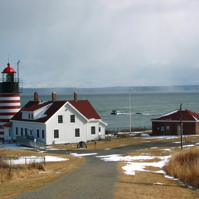 Foreground, West Quoddy Head Light, Lubec, Maine; background, Quoddy Narrows and Grand Manan Island amid a snow storm