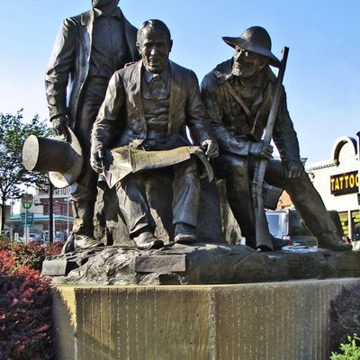 Pioneer Square Monument, Kansas City, Missouri. Located at Broadway & Westport Road, Kansas City, MO; the statues show features Pony Express founder Alexander Majors, Westport/Kansas City founder John Calvin McCoy and mountainman Jim Bridger.