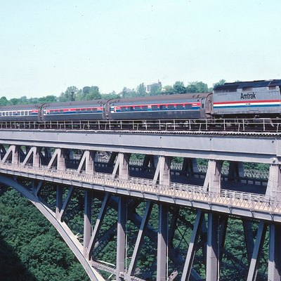 Amtrak #62, the Maple Leaf, crossing the Whirlpool Bridge over the Niagara River. Niagara Falls NY/Ontario June 1983. Scan from 35mm slide.