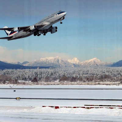 Boeing 747 of Cathay Pacific Cargo taking off from Vancouver International Airport in a rare snowy day.