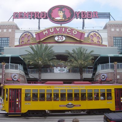 The Centro Ybor with a TECO Line Streetcar crossing in front, Ybor City, Tampa, Florida.