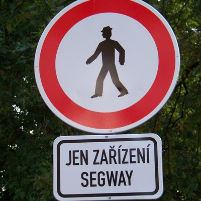 Before 2016, the Ministry of Transport of the Czech Republic enforced the interpretation that Segway PTs fall under pedestrian status. This road sign forbids Segways but allows