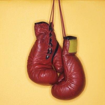 Women sometimes use men's boxing gloves.