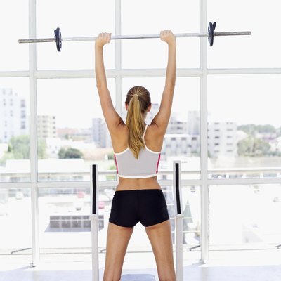 The standing shoulder press builds balance and coordination.